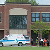 JOED VIERA/STAFF PHOTOGRAPHER-Lockport, NY-Emergency crews transfer a child that fell from the second story of Emmet Belknap Intermediate School from an ambulance onto Mercy Flight.