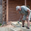 JOED VIERA/STAFF PHOTOGRAPHER-Olcott, NY-Dan Horanburg intalls an access ramp at Ye Olde Log Cabin in Krull Park.