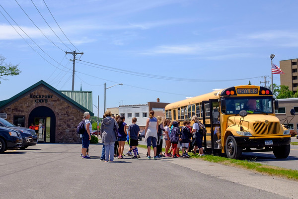 JOED VIERA/STAFF PHOTOGRAPHER-Lockport, NY-East Aurora Students board a bus after their school field trip to the Lockport Caves.