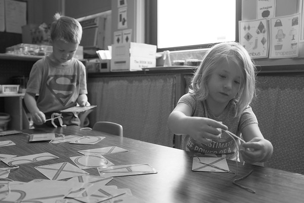 JOED VIERA/STAFF PHOTOGRAPHER-Lockport, NY-Universal Pre-K students Henry Mulvey, 5, and Emma Drake, 4, work with letters during an assignment in Charlene Jones' all-day class at John E Pound Early Childhood Center.