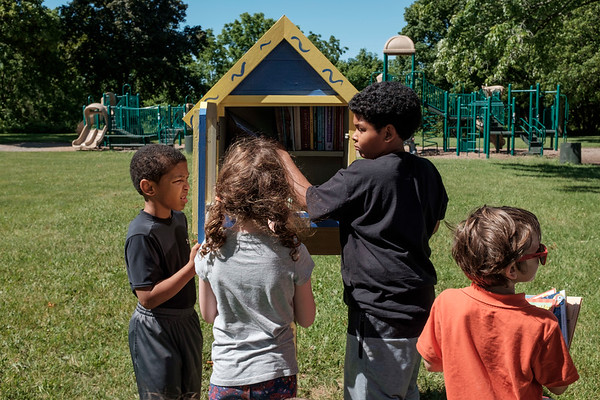 JOED VIERA/STAFF PHOTOGRAPHER-Cadon Rogers, 7, Lena Tobin, 8, Quason Rogers, 12, and Sebastian Wrobel 6 fill the new Outwater Park Little Library.