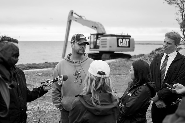 JOED VIERA/STAFF PHOTOGRAPHER-Olcott, NY-Dean Lapp, the Niagara County highway chief speaks with reporters as an excavator moves the lake bed.