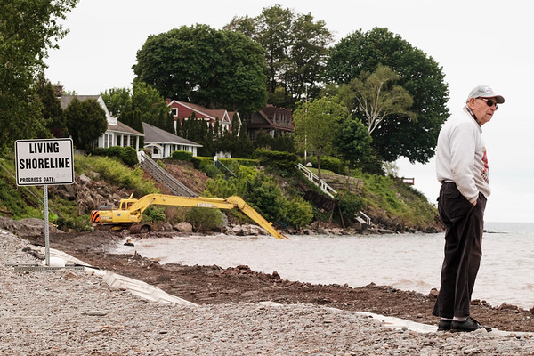 JOED VIERA/STAFF PHOTOGRAPHER-Olcott, NY-Newfane resident Donald Pohl watches as an excavator moves the lake bed.