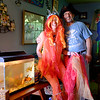 JOED VIERA/STAFF PHOTOGRAPHER-Wrights Corner, NY-Kim Richaw and James Dean Bonds by their fish tank. The two are getting married at the Mermaid Parade on June 17th.