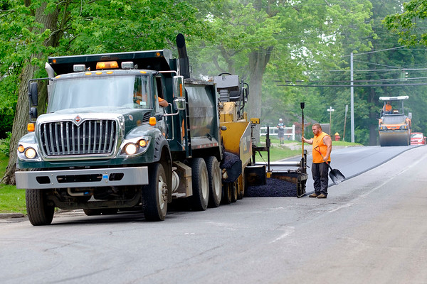 JOED VIERA/STAFF PHOTOGRAPHER-Lockport, NY-City crews lay down blacktop on Washburn Street near High Street.
