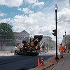 JOED VIERA/STAFF PHOTOGRAPHER- City crews lay blacktop down along Main Street.