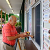 JOED VIERA/STAFF PHOTOGRAPHER-John Adams buys an icecream sundae from Harris Farm Market.