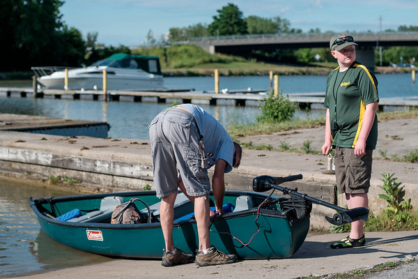 JOED VIERA/STAFF PHOTOGRAPHER-John Bullock and his son Hunter, 13, a Boy Scout from troop 4 out of St Johns Episcopal Church prepare for canoe training along the Canal.