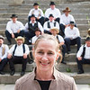 JOED VIERA/STAFF PHOTOGRAPHER- Lockport, NY-Sue Geisler stands in front of re-enactors during an event at the Flight of Five. Geisler is working on a lock tenders tribute statue.
