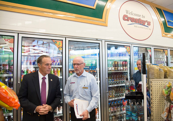 JOED VIERA/STAFF PHOTOGRAPHER-Lockport, NY-Congressman Chris Collins speaks with Reids Inc Vice President Doug Galli during a tour of Crosby's on Lake Avenue.