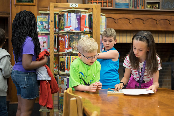 JOED VIERA/STAFF PHOTOGRAPHER-Lockport, NY-Anna Merritt 3rd and 4th graders compete in a scavenger hunt searching for  books, audio books and graphic novels at the Lockport Public Library. The students were at the Library for a walking field trip. Some students applied for library cards while those who had them checked out books.