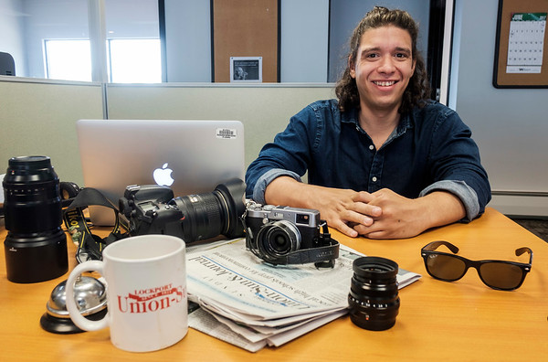 JOED VIERA/STAFF PHOTOGRAPHER-Lockport Union-Sun & Journal staff photographer Joed Viera sits at his desk for a self portrait.
