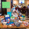 JOED VIERA/STAFF PHOTOGRAPHER- Sic tables are stacked with donations to  Heather Haley's SPCA fundraiser at the Navy Marine Club.