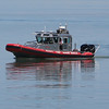 Stephen M. Wallace/Contributer-Wilson, NY-An Olcott fire rescue boat searches for a reported body in Lake Ontario. An Ontario Street resident called the sheriffs office Thursday afternoon to report seeing a man on a raft and later seeing the same raft manless.