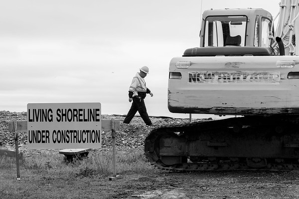JOED VIERA/STAFF PHOTOGRAPHER-Olcott, NY-An operator walks by an excavator whileworking on moving the lake bed.