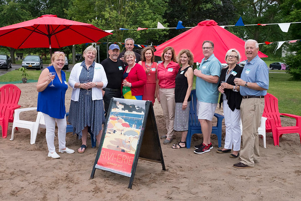 JOED VIERA/STAFF PHOTOGRAPHER-Contributers to the success of the Rivi-Erie stand in the makeshift beach along the Erie Canal shoreline by Nelson C. Goehle Marina.