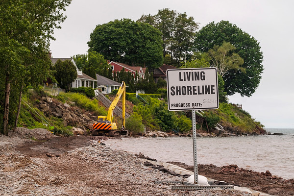 JOED VIERA/STAFF PHOTOGRAPHER-Olcott, NY-An excavator moves the lake bed.