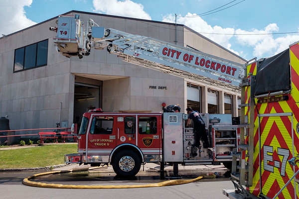JOED VIERA/STAFF PHOTOGRAPHER-City of Lockport firefighters test their hoses for leaks outside of 1 Locks City Plaza.