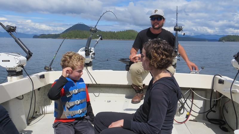 DISCUSSING SERIOUS FISHING WITH OUR GUIDE, NOLAN