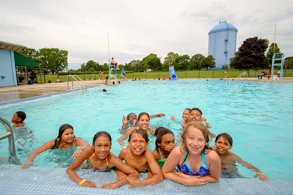 JOED VIERA/STAFF PHOTOGRAPHER-Lockport's Community pool fills up with kids during afternoon open swim.