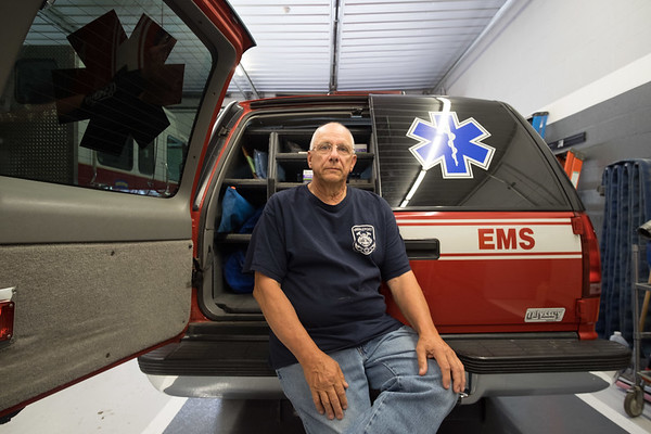 JOED VIERA/STAFF PHOTOGRAPHER-Middleport Fire Department 1st Asst. Chief Jim Volkosh outside the deparment's EMS vehicle.