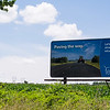 JOED VIERA/STAFF PHOTOGRAPHER-Pro wind power billboards like this one on Rochester Road have been popping up in an apparent counter to recent Save Ontario Shores anti turbine billboards.
