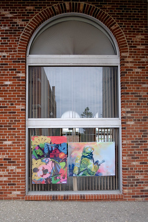 JOED VIERA/STAFF PHOTOGRAPHER-Art hangs on the window of a vacant property on the corner of Main and Locust Streets.