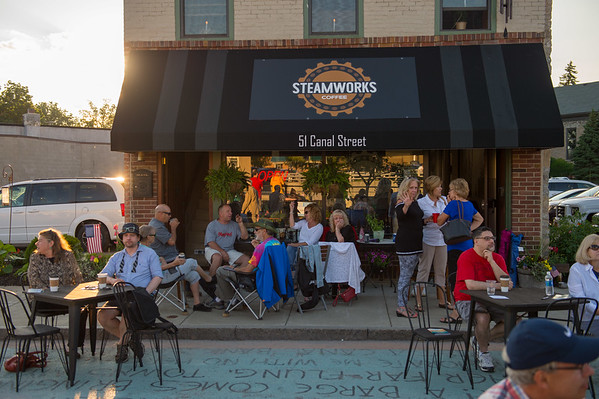 People sit outside Steamworks Coffee before the Albany Symphony's Water Music New York concert. (Joed Viera/Lockport Union-Sun & Journal)