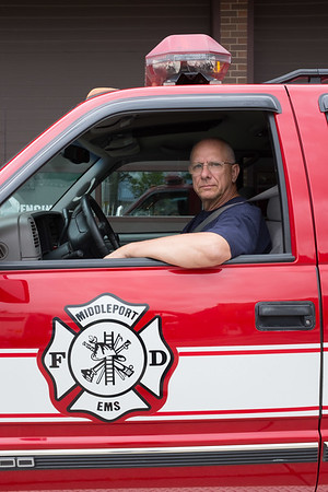 JOED VIERA/STAFF PHOTOGRAPHER-Middleport Fire Department 1st Asst. Chief Jim Volkosh inside the deparment's EMS vehicle.