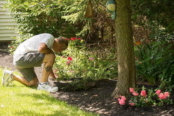 JOED VIERA/STAFF PHOTOGRAPHER-Jim Fiscus tends to his garden on Bear Ridge Road before the Pendleton Garden Show.