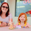 JOED VIERA/STAFF PHOTOGRAPHER-Brooke Smith and her daughter Sabrina, 4, enjoy sundaes at JoJo's Ice Cream during their grand opening celebration.