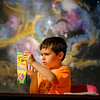 JOED VIERA/STAFF PHOTOGRAPHER-Enzo Conjerti, 6, picks colors before drawing constellations during Challeger Learning Center's Mini-Camp. Each day participants in the program learn about space before making art involving the subjects they've learned about.  The camp started on July 6th and has two three-hour-long classes every Thursday through August 10th. The classes run from 9am to 12pm and from 1pm. to 4pm.