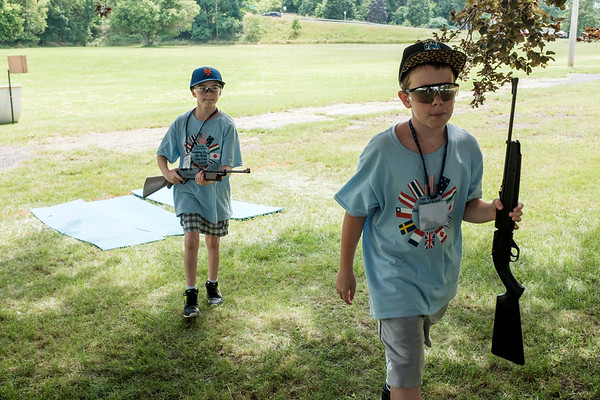 JOED VIERA/STAFF PHOTOGRAPHER-Den seven Cub Scouts Thomas Tomson, 10 and Jackson Pike, 9, carry bbguns back to storage after firing them on a range during the Scouts' weeklong day camp.