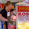 JOED VIERA/STAFF PHOTOGRAPHER-Calli Ross, 17, makes popcorn during Ross Rental's 25th anniversary celebration.