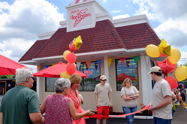 JOED VIERA/STAFF PHOTOGRAPHER-Tuesday, JoJo's Ice Cream celebrated their grand opening with a ribbon cutting ceremony.