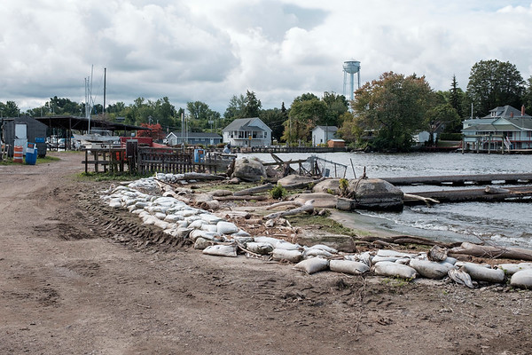 Joed Viera/Staff Photographer-Sand bags struggled to hold back Lake Ontario's recent high water levels from damaging Hedley Boat Company in . David Hedley is in the midst of repairing the Boat Company, which has been in his family for a hundred years.