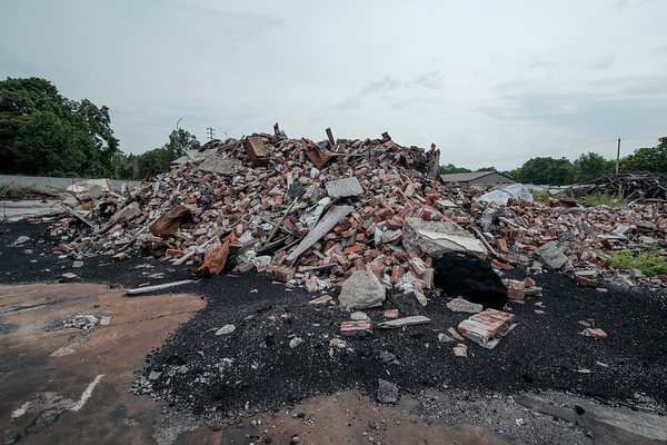 JOED VIERA/STAFF PHOTOGRAPHER-The remains of a building destroyed by the fire at HTI last August lies in rubble.