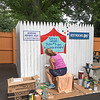 CONTRIBUTED PHOTO-A woman paints a sign on the new Mothers Area at Olcott Carousel Park.