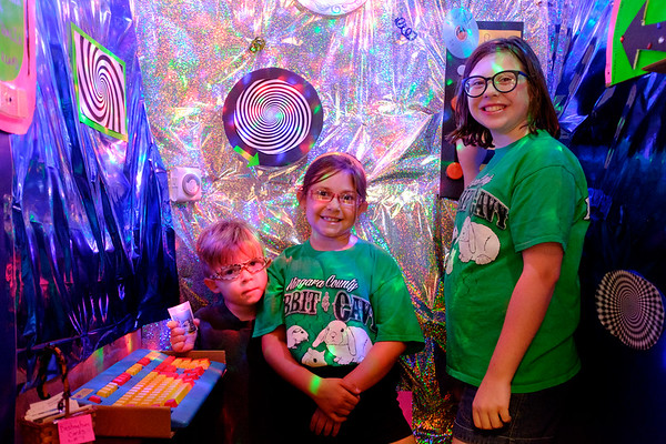 JOED VIERA/STAFF PHOTOGRAPHER-Maxim, Mariana and Miracle Martin show off their time machine at the Niagara County Fair. Mariana and Miracle, both 4H participants, helped publish a time travel themed book featuring stories from other 4H kids.