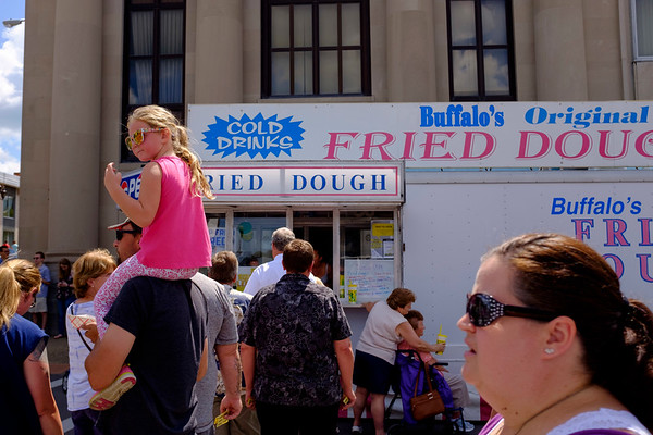 Joed Viera/Staff Photographer-A scene in front of Buffalo's Original Fried Dough during this year's Taste of Lockport.