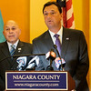 State Assemblyman Angelo J. Morinello, left,  looks on as Niagara County Legislator Randy Bradt calls for the resignation of members of the Niagara Falls water board at the Niagara County Courthouse on Thursday, Aug. 3rd, 2017 in Lockport, N.Y. The call for resignations comes after a discharge of dark substance from the Niagara Falls wastewater treatment plant into the Niagara River on Saturday, Aug. 29th.(Joed Viera/Lockport Union-Sun & Journal)