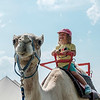 JOED VIERA/STAFF PHOTOGRAPHER- Emilia Wochna 4 rides a camel at the Niagara County Fair.