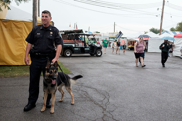 JOED VIERA/STAFF PHOTOGRAPHER- Niagara County Sheriffs Deputy Richard Bull and EJ the Sheriffs Department's new K9 during a demonstration at the Niagara County Fair.