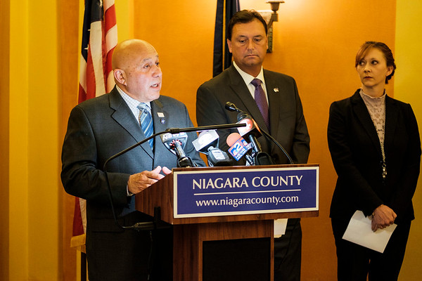 Niagara County Legislators Randy Bradt, center,  and Rebecca Wydysh, right,  look on as State Assemblyman Angelo J. Morinello calls for the resignation of members of the Niagara Falls water board at the Niagara County Courthouse on Thursday, Aug. 3rd, 2017 in Lockport, N.Y. The call for resignations comes after a discharge of dark substance from the Niagara Falls wastewater treatment plant into the Niagara River on Saturday, Aug. 29th.(Joed Viera/Lockport Union-Sun & Journal)