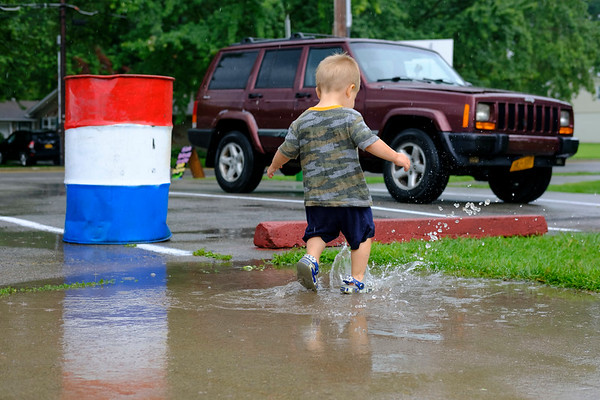 JOED VIERA/STAFF PHOTOGRAPHER-Caleb Fisher plays in a puddle by the Riverie Beach.