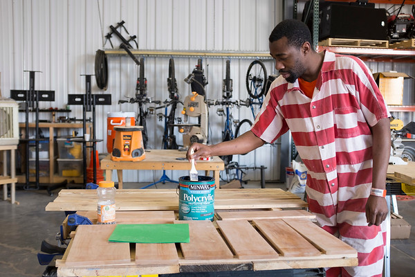 Joed Viera/Staff Photographer-Niagara County Jail inmate Matthew McPhatter applys a protective finish onto one of the benches. McPhatter is a participant in a BOCES vocational program for non-violent inmates at the jail.