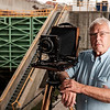 JOED VIERA/STAFF PHOTOGRAPHER-Dennis Stierer poses with his large format 5x7 camera by the Locks.
