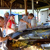 JOED VIERA/STAFF PHOTOGRAPHER-Volunteers make eggs and hashbrowns on a large circular griddle for the annual Farmers Breakfast at the Niagara County Fair.