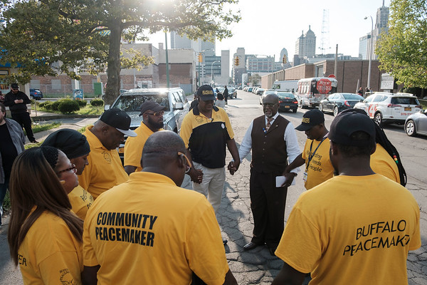 Greater Works Deliverance Fellowship Pastor and VOICE-Buffalo President James E. Giles leads the Buffalo Peacemakers in prayer outside Durham Memorial A.M.E. Zion Church in Buffalo, N.Y.  during a vigil held for Heather Heyer, Lieutenant H. Jay Cullen and Trooper Berke M. M. Bates on Wednesday, Aug. 16, 2017.(Joed Viera/Lockport Union-Sun & Journal)