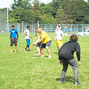 JOHN D'ONOFRIO/STAFF<br /> Lockport High School junior varsity football assistant coach Trait Smith, center, snaps the ball during a mock drill at practice on Aug. 14 at LHS.